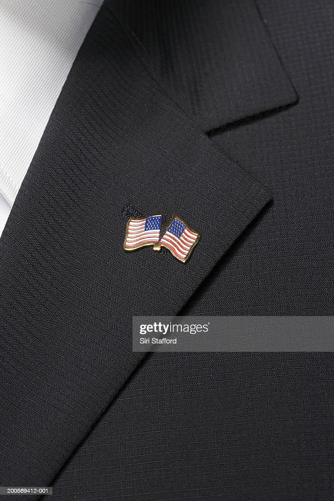 Close up of American flag pin on lapel : Foto de stock