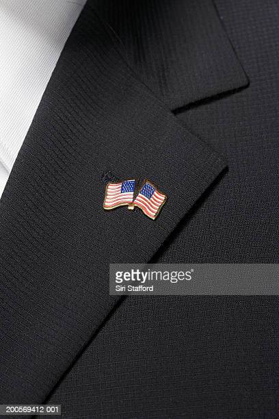 Close up of American flag pin on lapel