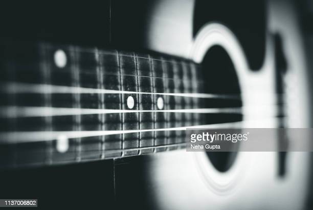 close up of an acoustic guitar - monochrome - stringed instrument stock pictures, royalty-free photos & images