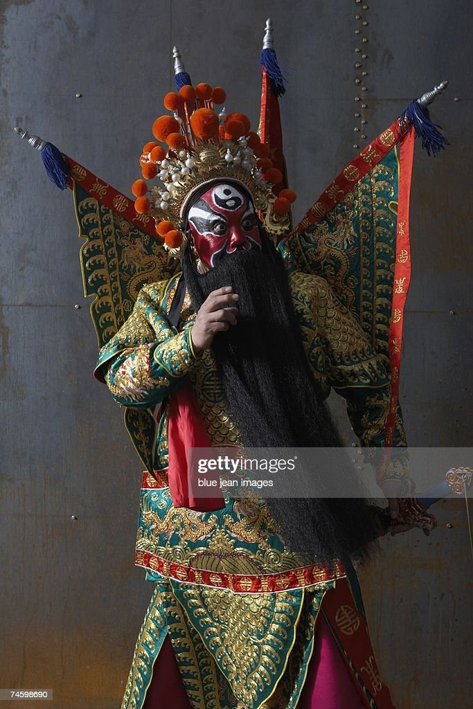 Close up of an actor dressed as traditional Beijing Opera Army General posing in martial arts stance. : Stock Photo