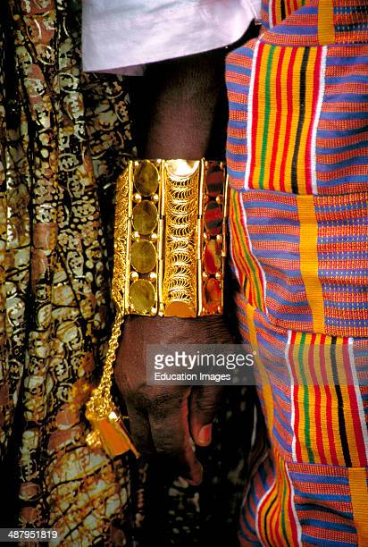 Close up of an Akan king's arm showing a traditional Ashanti bracelet made of pure gold. Such displays of wealth are a common sight at Durbars,...