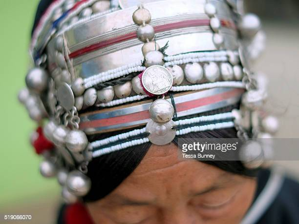 Close up of an Akha womens headdress Muang Long Luang Namtha province Lao PDR The headdress is made from hand forged silver coins handwoven cotton...