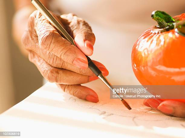 close up of an elderly woman painting - newhealth stock pictures, royalty-free photos & images