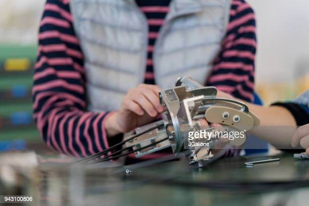 Close up of an engineering student working on a robotics design