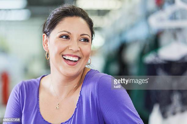 close up of an hispanic woman laughing - purple shirt stock photos and pictures