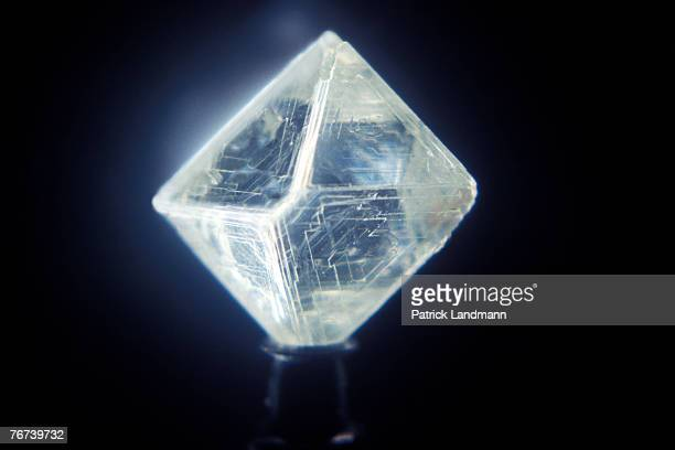 A close up of an octahedron diamond which highlights the equilateral triangles characteristic of these stones