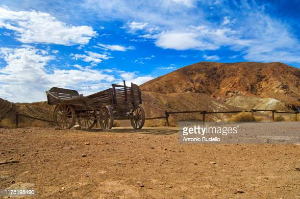 close up of an old pioneer wooden wagon in calico - wild west stock pictures, royalty-free photos & images