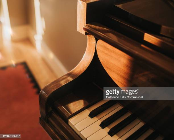 close up of an old wooden baby grand piano - human joint stock pictures, royalty-free photos & images