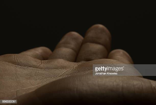 close up of an open male hands, dark skin - reaching stock pictures, royalty-free photos & images