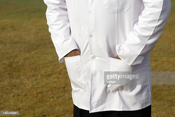 Close up of an umpires hand in his pocket