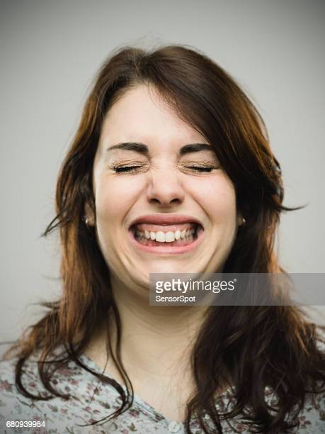 Close up of angry woman clenching teeth
