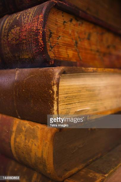 Close up of antique books in leather covers, studio shot