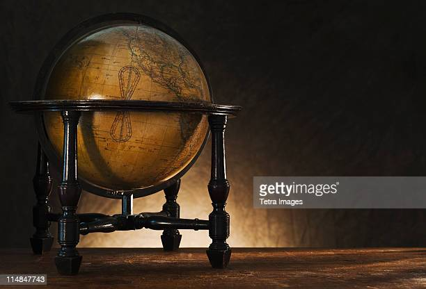 Close up of antique globe on table