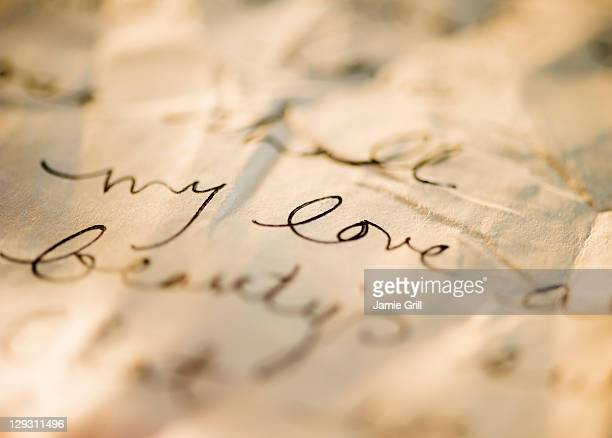 close up of antique love letter on parchment  - bericht stockfoto's en -beelden