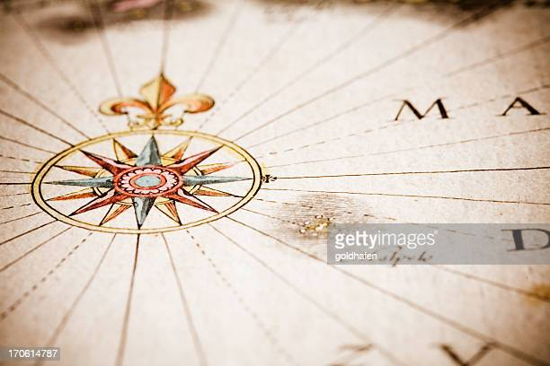 Close up of antique style compass on old map