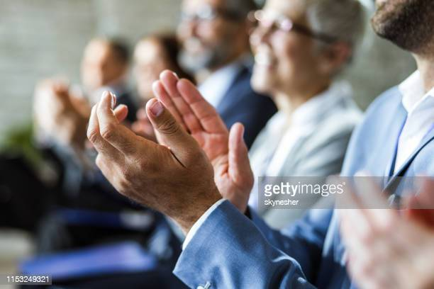 close up of applauding on education event. - applauding stock pictures, royalty-free photos & images