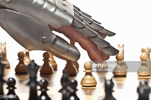 Close up of armored hand playing chess