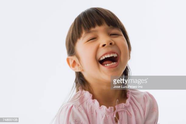 Close up of Asian girl laughing