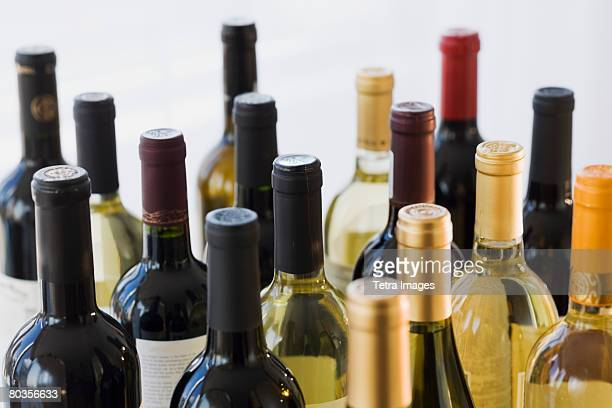 close up of assorted wine bottles - wine bottle stock pictures, royalty-free photos & images