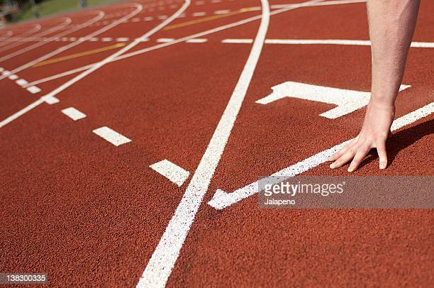 close up of athlete's hand on track - forward athlete stock pictures, royalty-free photos & images