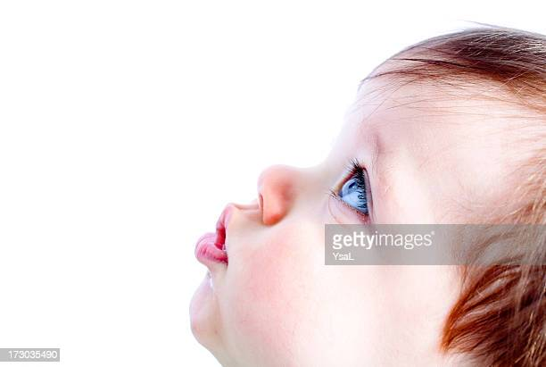 Close up of babies face behind purple screen