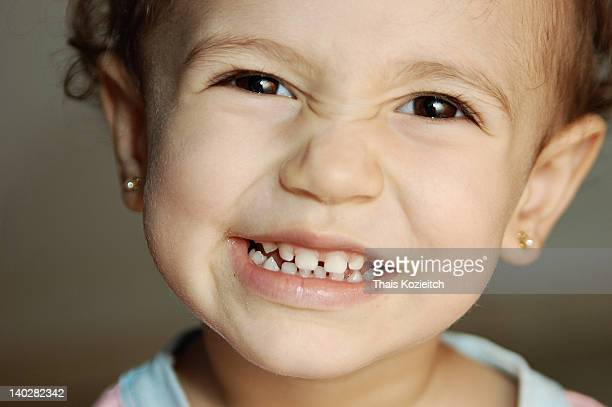close up of baby girl smiling - orecchini foto e immagini stock