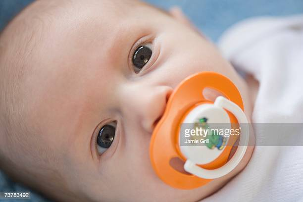 Close up of baby with pacifier