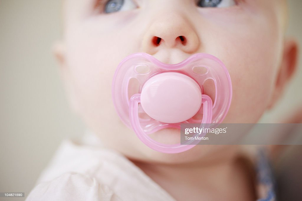 Close up of baby with pink pacifier : Stock Photo