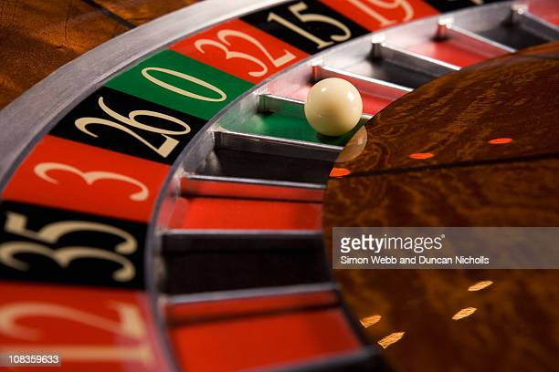 close up of ball on roulette wheel - gambling stock pictures, royalty-free photos & images