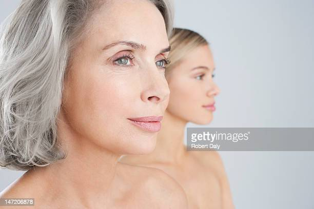 close up of bare chested mother and daughter - beautiful woman chest stock photos and pictures