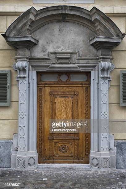 close up of baroque style old wooden door ,lucerne. - emreturanphoto stock pictures, royalty-free photos & images