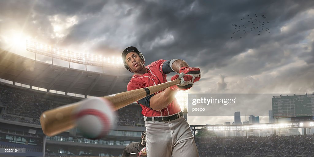 Close Up of Baseball Player Hitting Ball : Stock Photo