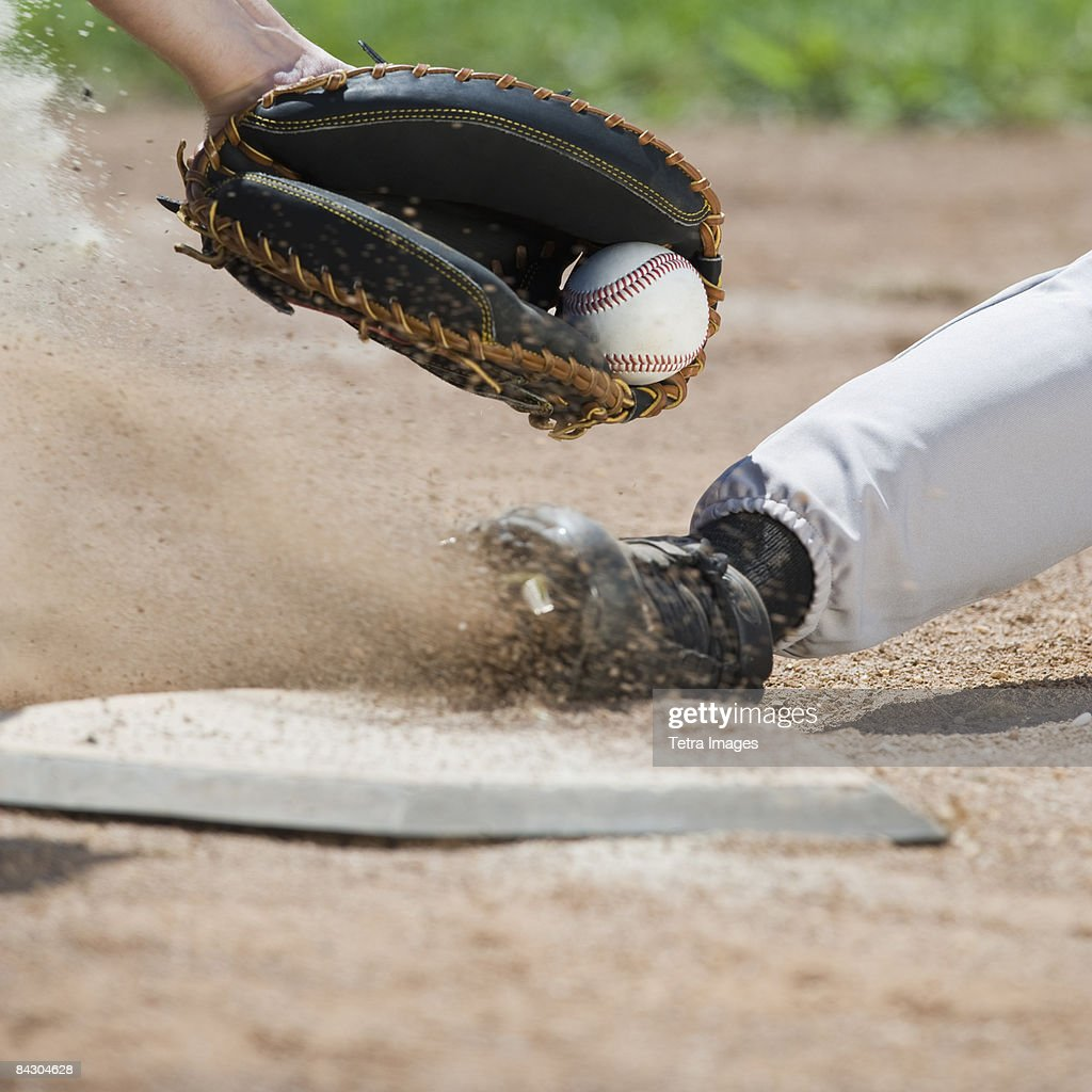Close up of baseball player sliding into home plate : Stock Photo