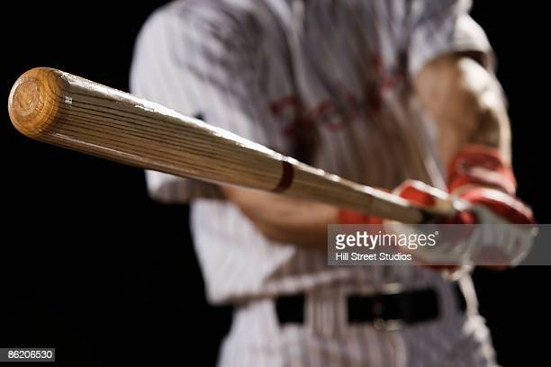 close up of baseball player swinging bat - bastão de beisebol - fotografias e filmes do acervo
