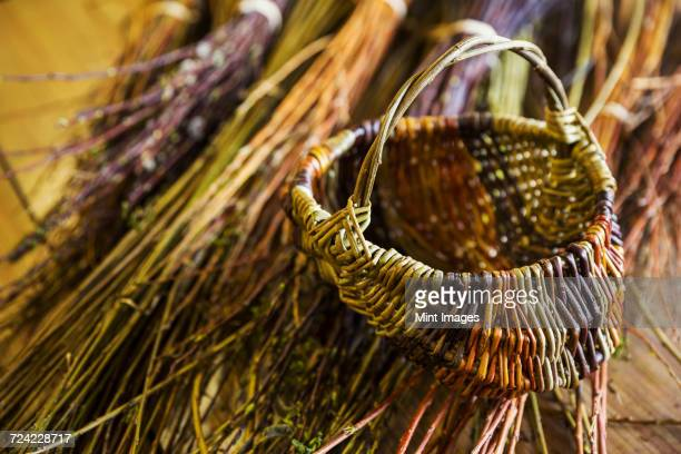 Close up of basket and willow bundles in a basket weavers workshop.