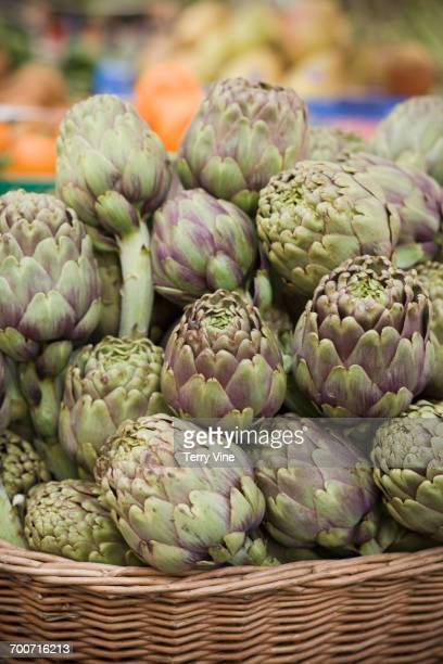 close up of basket of artichokes - carciofo foto e immagini stock
