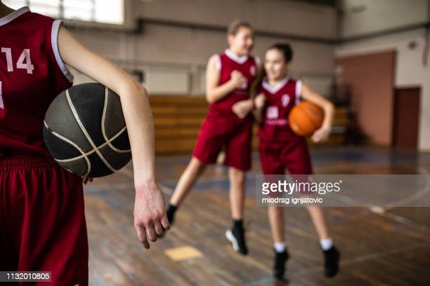 close up of basketball ball in human hands - charging sports stock pictures, royalty-free photos & images