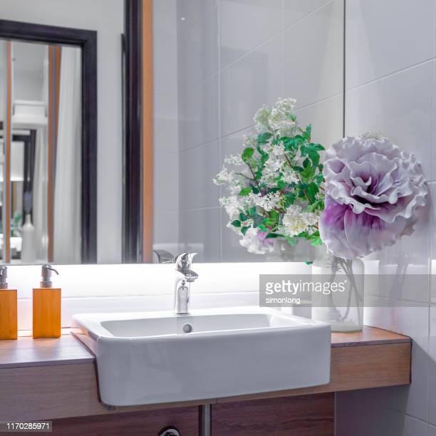 close up of bathroom sink and mirror - specchietto foto e immagini stock