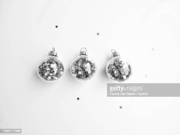 Close Up Of Baubles Over White Background