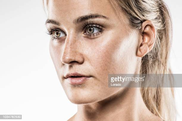 close up of beautiful blonde female model - freckle stock photos and pictures