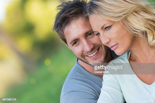 close up of beautiful couple sitting in the nature - may december romance stock photos and pictures