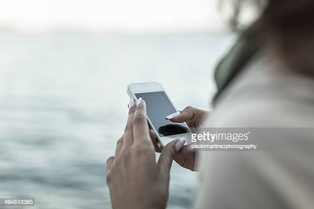Close up of beautiful hands typing smartphone