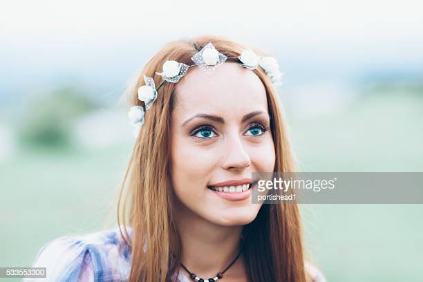 Close up of beautiful smiling girl with wreath