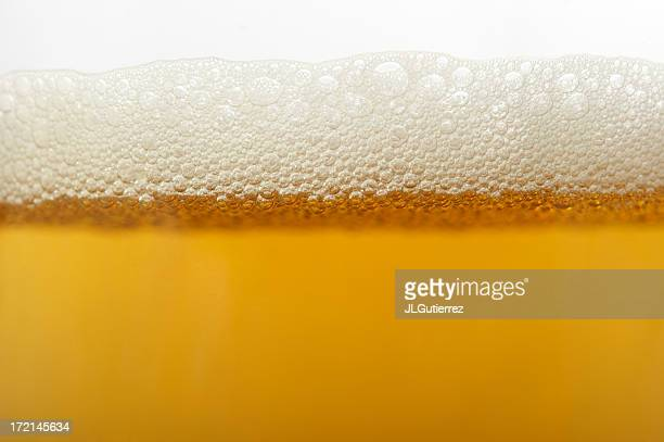 Close up of beer bubbles in glass