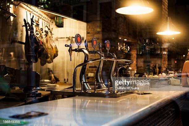 Close up of beer taps at bar