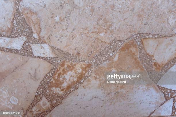 close up of beige and cream colored terrazzo - dorte fjalland fotografías e imágenes de stock