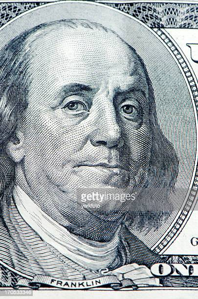 Close up of Benjamin Franklin on bank note