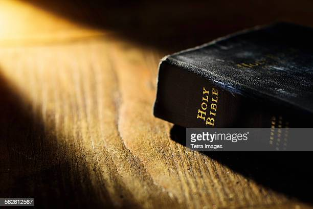close up of bible on table - bible stock pictures, royalty-free photos & images