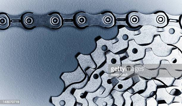 close up of bicycle chain and gears - link chain part stock photos and pictures