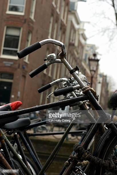 close up of bicycles in amsterdam street - lyn holly coorg stock pictures, royalty-free photos & images